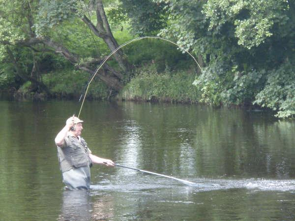 Martin Busk nets a sea trout in Tyndals: June 2009